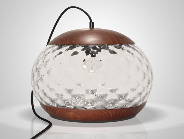 Mariana Costa e Silva has designed the Jar Lamp, a simple glass and wood table l...