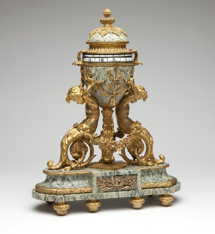 Swiss gilt bronze & marble annular clock, Gubelin : Lot 1101...