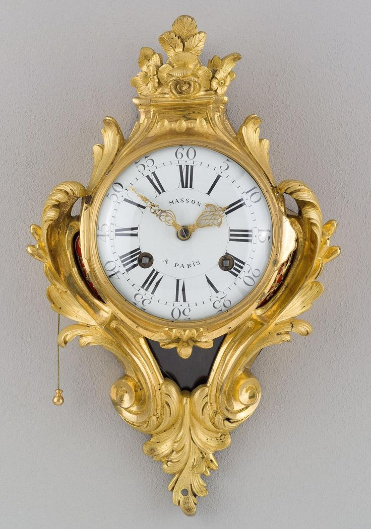 French Gilt Bronze Transitional Cartel Clock. Period ca. 1760-1770....