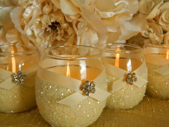 I could make these by dipping a candle holder in glue and glitter and putting ri...
