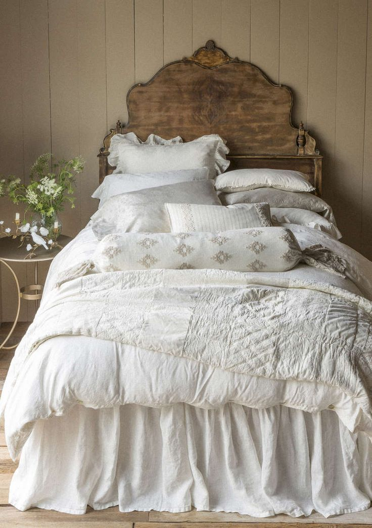 Prairie headboard plays with elegant linens.