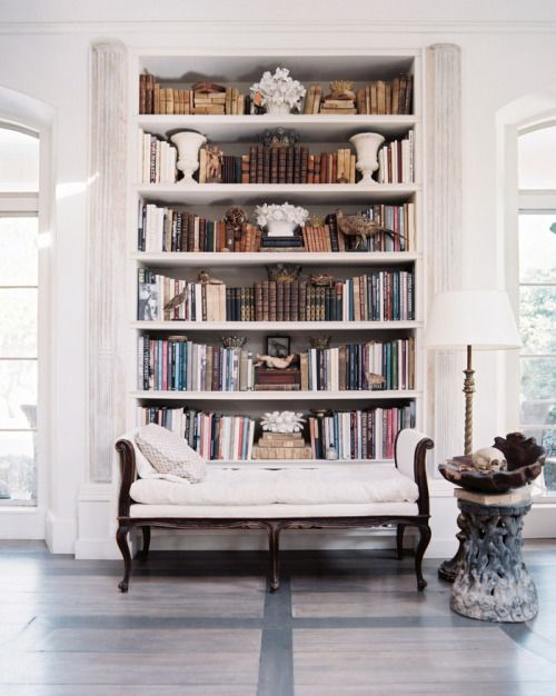 Bookshelf+between+balcon+doors+make+this+space+an+elegant+home+library...