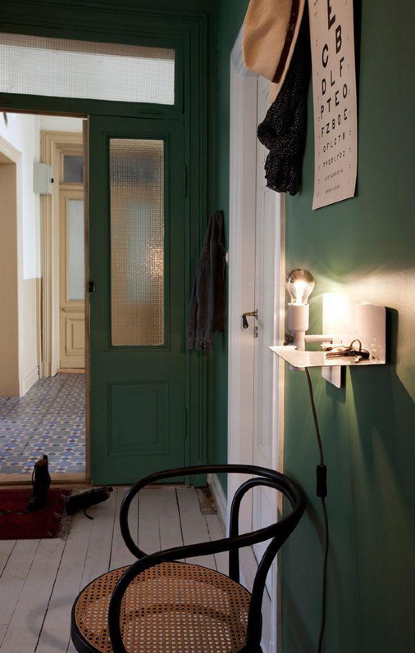 Dark green walls in hall way | Interior inspiration