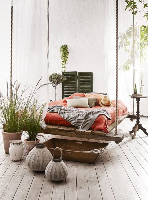 I love how the bed is suspended from the ceiling creating a swing effect.