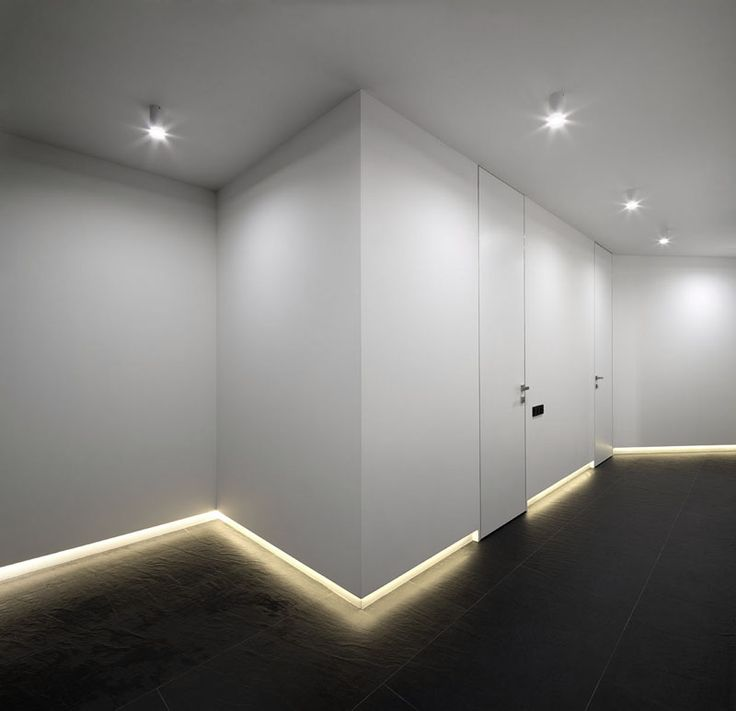 In this hallway, lighting along the floor, leads the way to the bedrooms and lau...