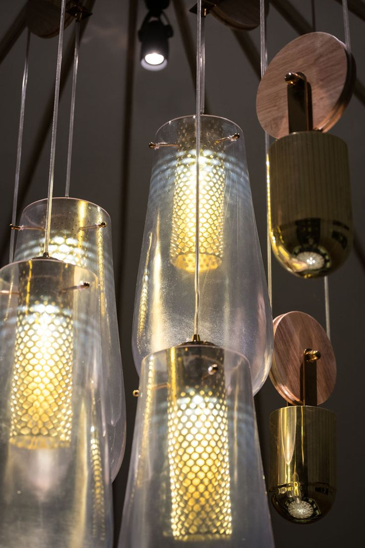 These custom-designed pendant lights are on a pulley system, and consist of a dr...