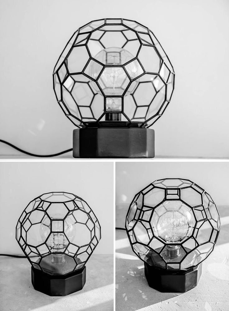 This modern circular black lamp is handmade from high quality materials like woo...