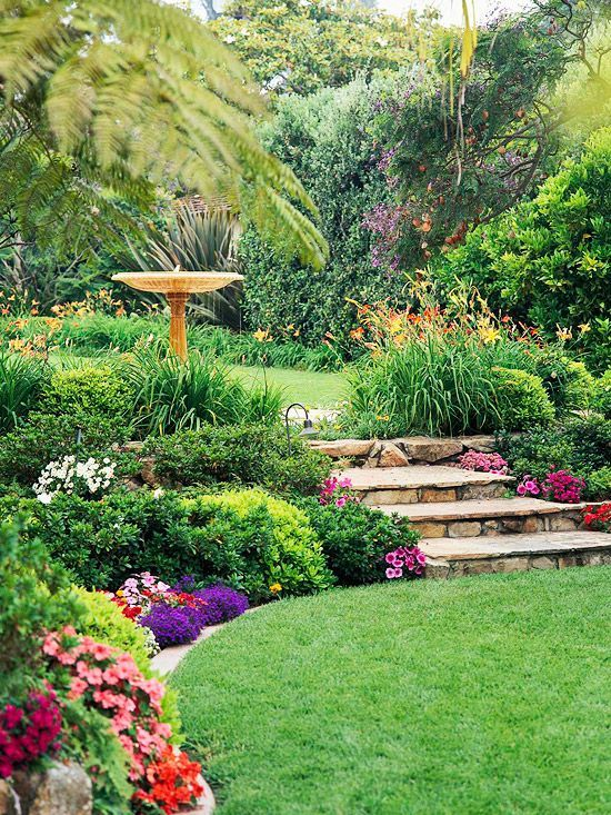 daylily border around top level; mixed low shrubs and annuals on lower.  Great s...