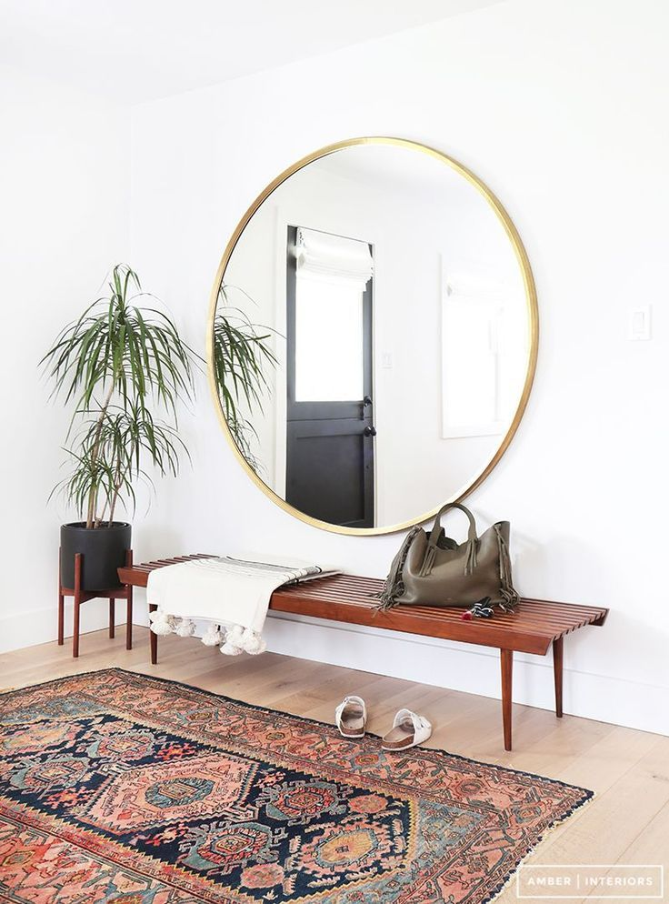 Midcentury modern meets bohemian entryway with a slatted bench, vintage Persian ...