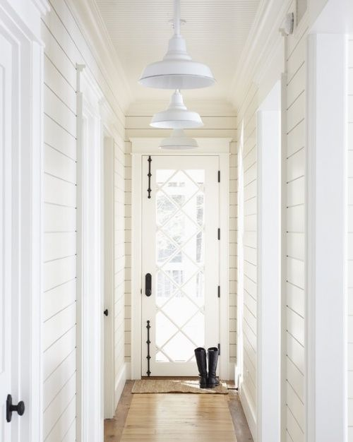 hallway with shiplap walls. Love the overhead lighting