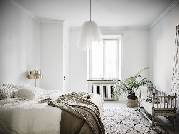 A serene bedroom in a stunning Swedish apartment in neutrals. Entrance / Jonas B...