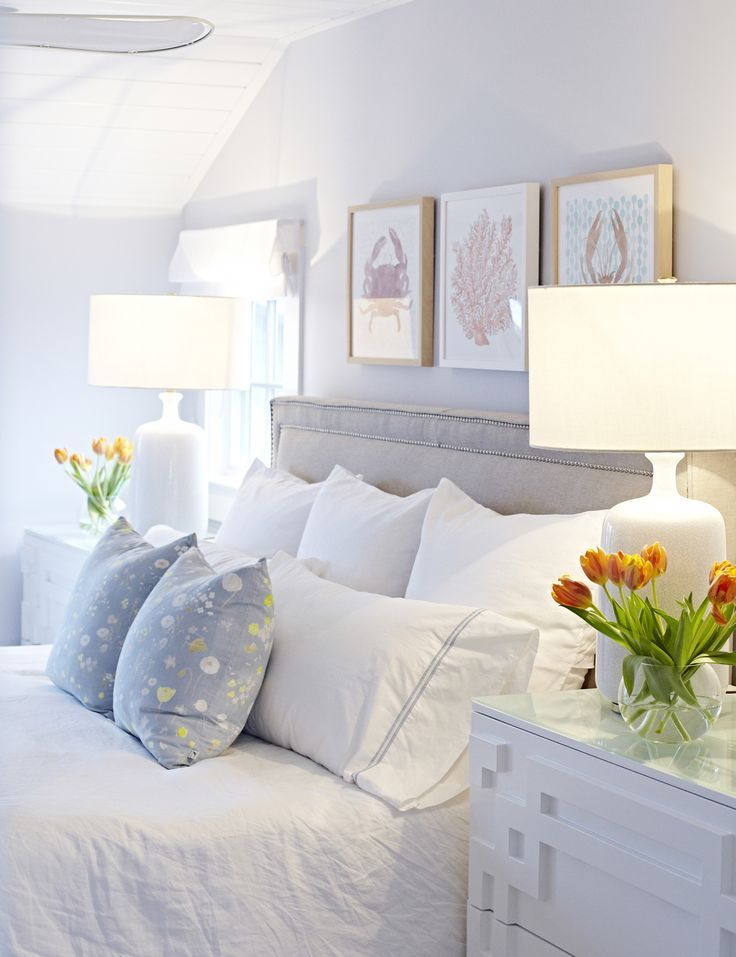 The more light, the bigger a room seems, so choose some matching bedside lights ...