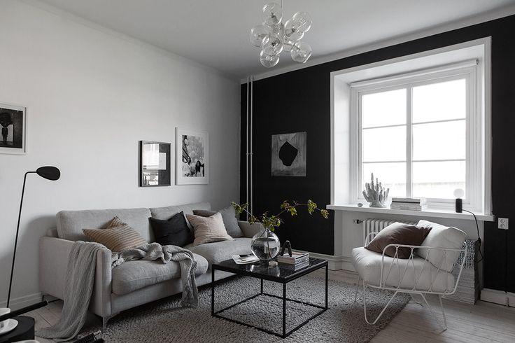 Scandinavian living room with black walls