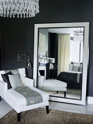 i love the idea of a big big floor mirror and a small seating area in the bedroo...