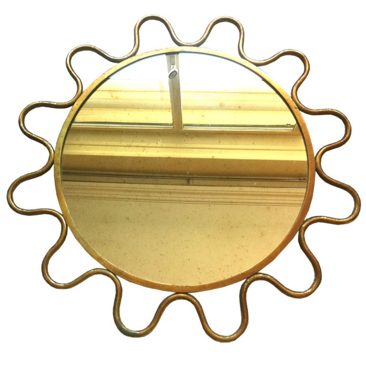 Jean Royere,  gold metal wave mirror, c.1950s/60s.