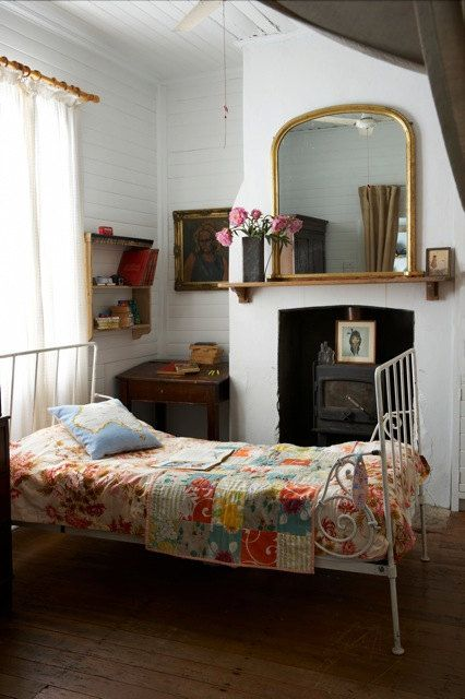 single bed with lovely quilt