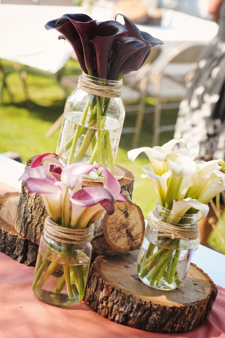 Simple centerpieces- change the flowers to hydrangea and peonies. Wood, mason ja...