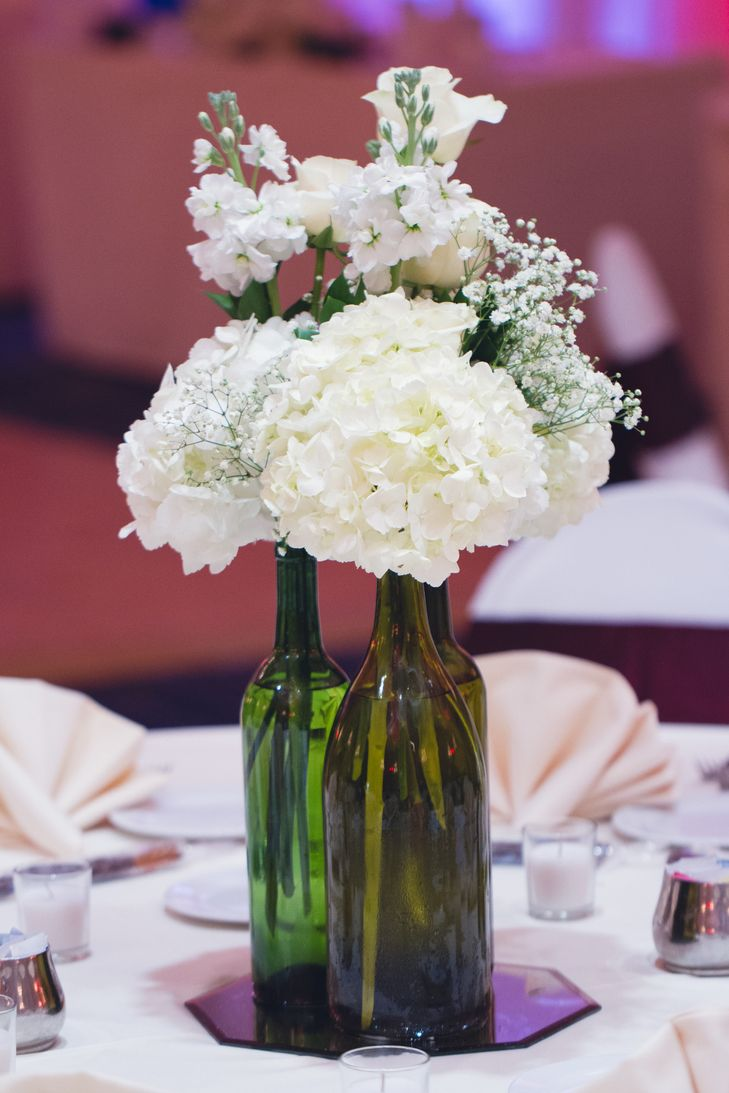 White Hydrangea in Wine Bottle Centerpieces | Horn Photography And Design www.th...