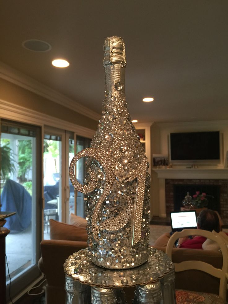 Glitter champagne bottle. Spray with silver spray paint, spray with spray glue a...