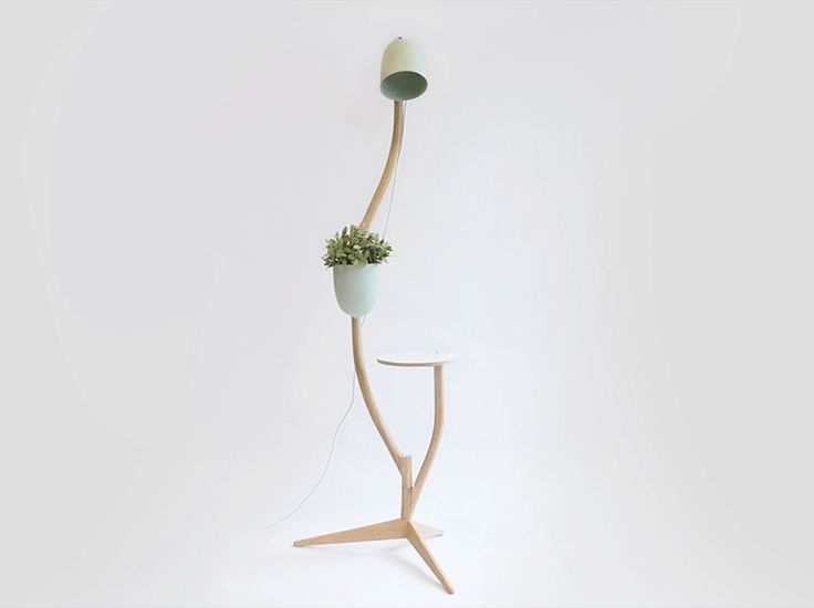 This whimsical piece of furniture is a lamp, table, and flowerpot in one