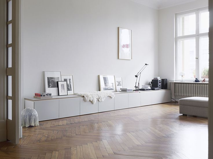 long clean white storage - Ikea Besta may work for this look