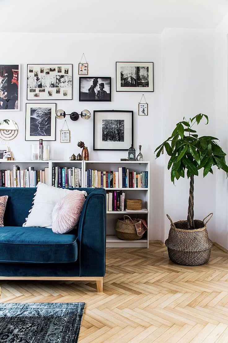 My scandinavian home gallery wall books and blue sofa