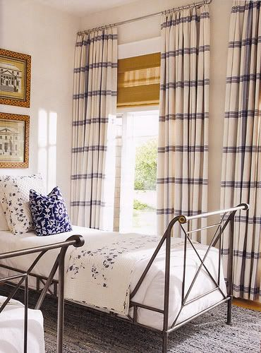Gorgeous blue and white bedroom.