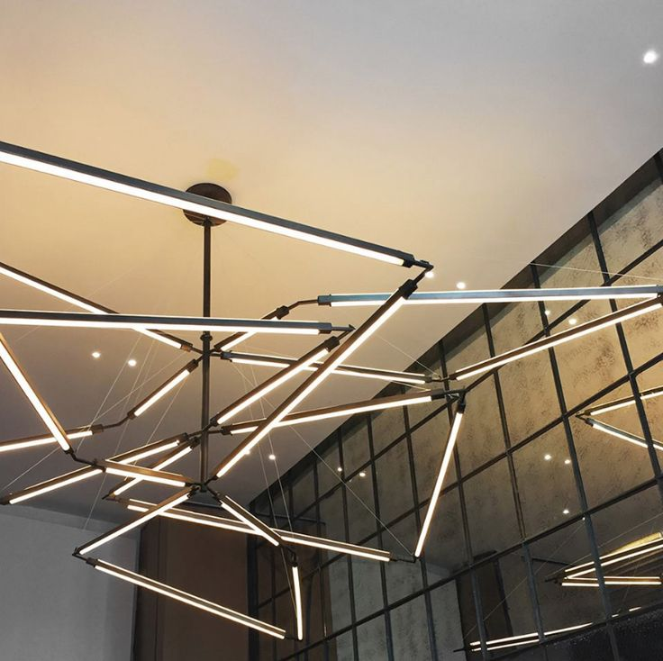 2ND Ave Lighting's intriguing Isotope Chandelier displays an array of geometri...