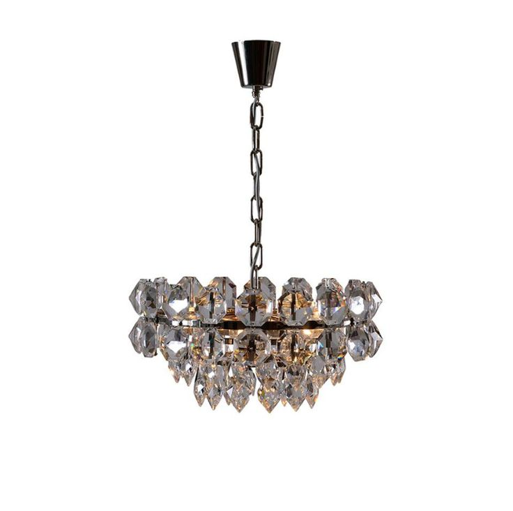 Large hand-cut crystal stones provide WOKA's Pompidou chandelier with its ch...