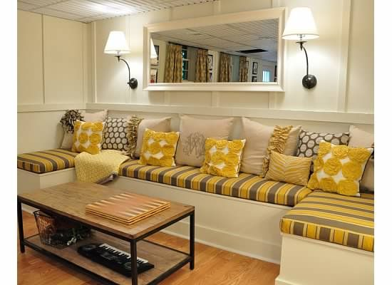 Love this built in DIY banquette for a basement! Bright, practical and cheery us...