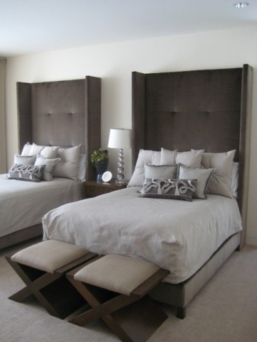 Grey on Grey modern bedroom. Upholstered headboards. Love how this is unisex wou...