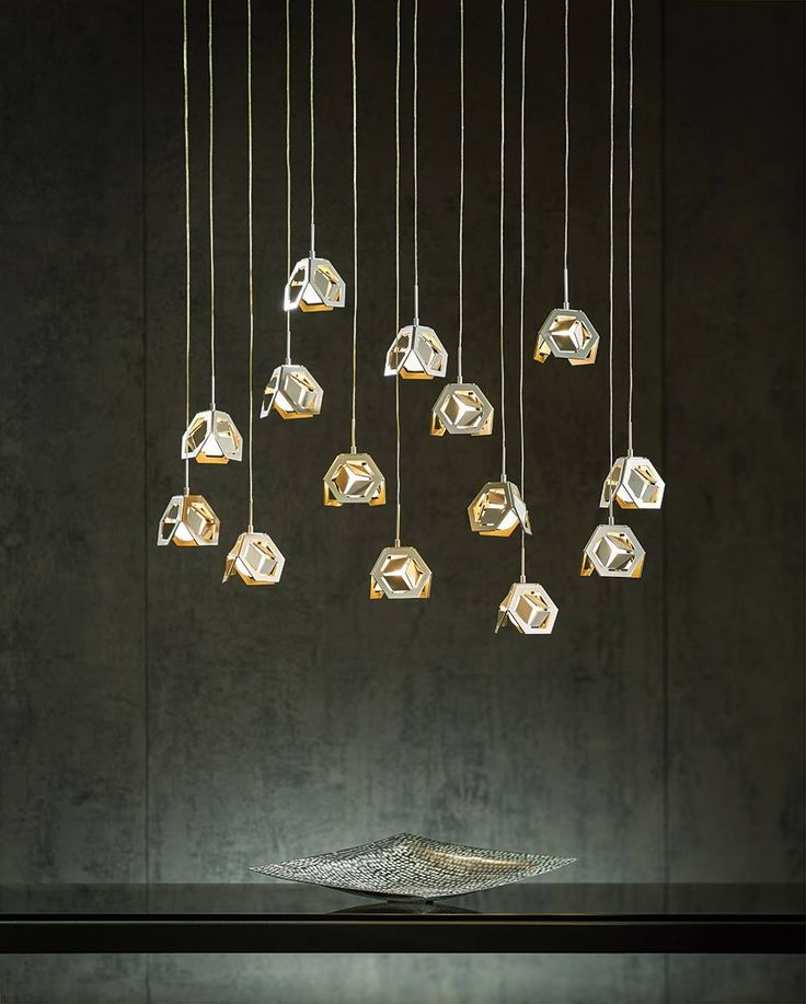 Each of Hubbardton Forge's Winter Low Voltage Mini Pendants are folded to shap...