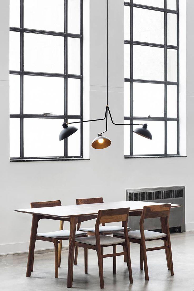 Swiveling shades add functional flexibility to Lambert & Fils studio's crisp, ...