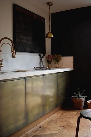 Kitchens by Brass Interiors- door fronts, panels, tiles here aged brass doors fo...