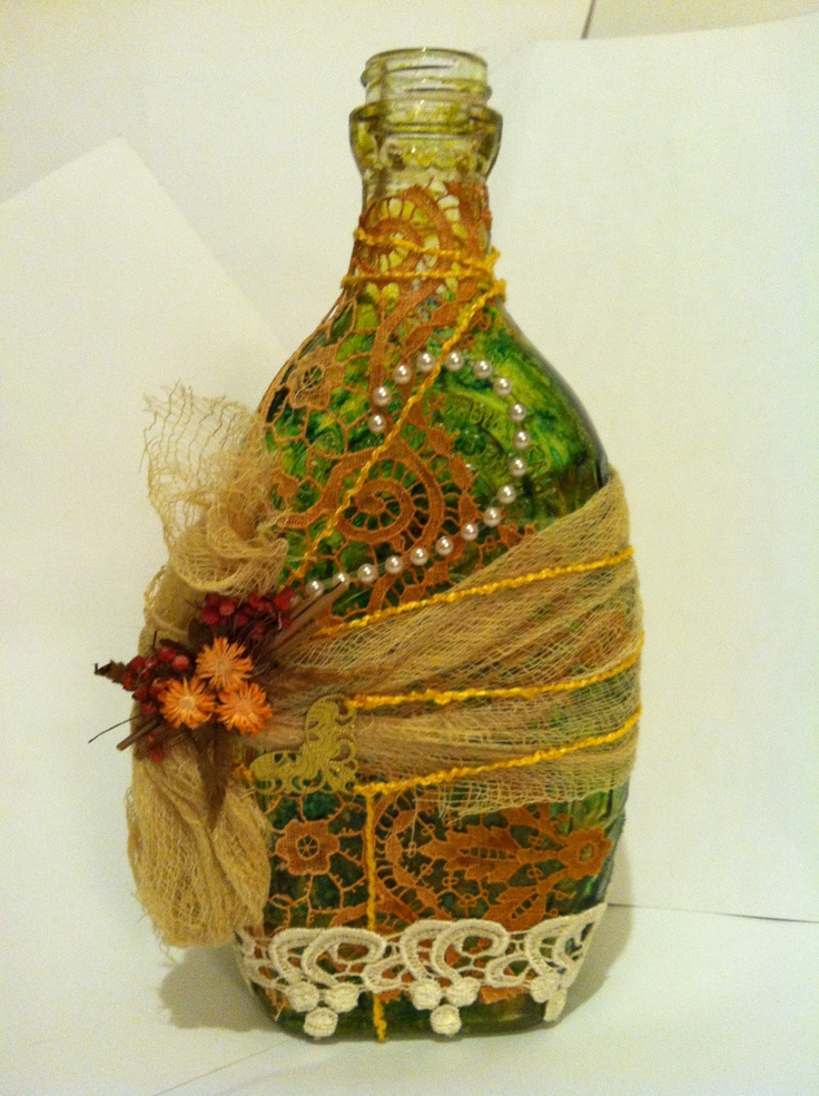Altered art bottle with lace and dried flowers