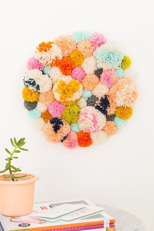 DIY Pom Pom Wall Hanging for any decor style.  Create your very own color palett...