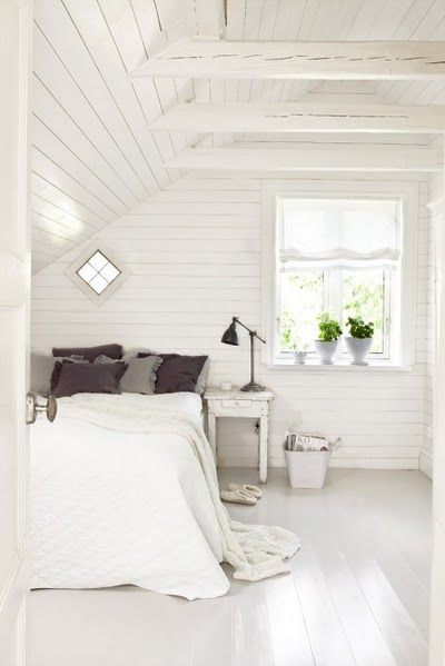 Loving this room! Lots of white and wood paneling. Cute little diamond-shaped wi...