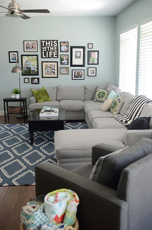 Aqua, taupe, black and white. This living is a perfect fit for family living wit...