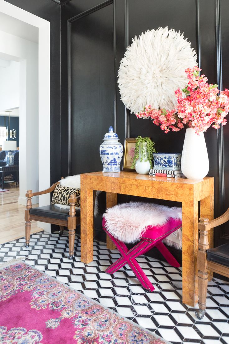How to Use a Juju Hat in Home Decor black painted wainscoating black walls entry...