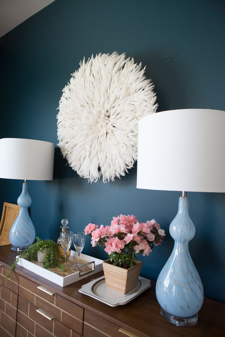 How to Use a Juju Hat in Home Decor dark green painted walls blue cascade lamps ...