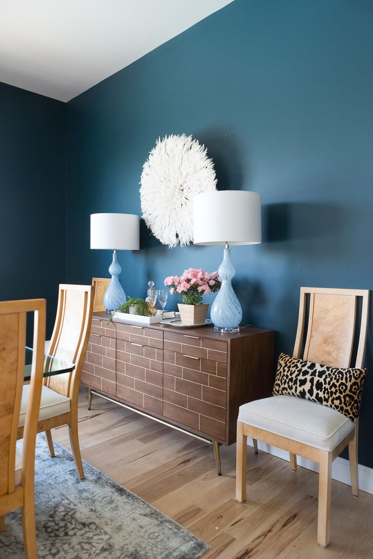 How to Use a Juju Hat in Home Decor dark green painted walls blue lamps burl woo...