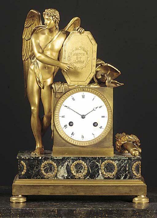 AN EMPIRE ORMOLU AND VERDE ANTICO MANTEL CLOCK | THE MOVEMENT BY RIEUSSEC | Chri...