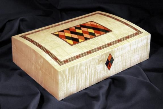 A domed top jewellery box veneered with figured maple, 10