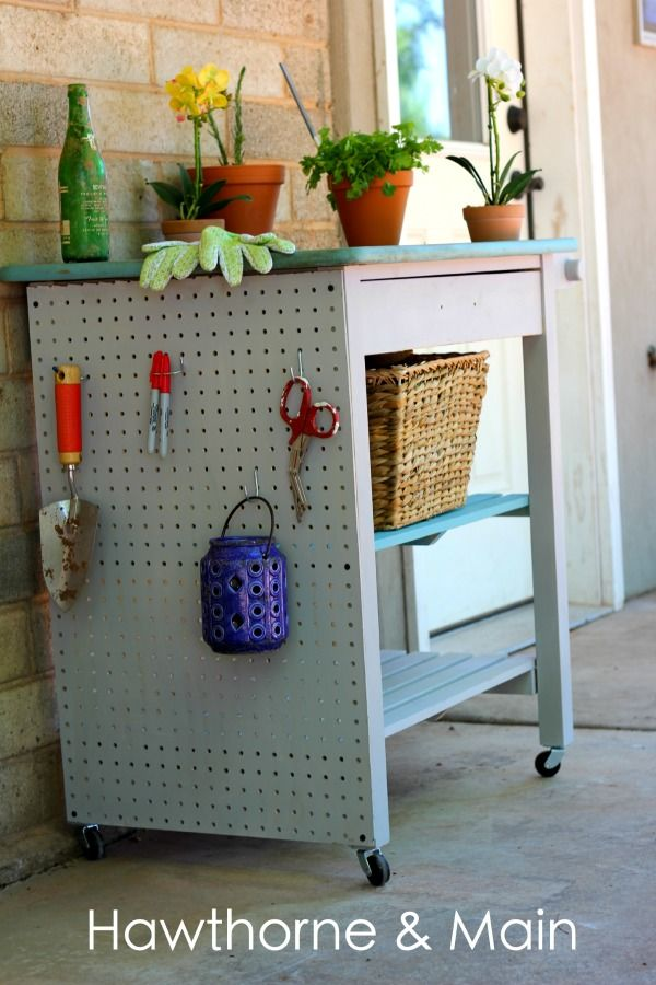 Kitchen Cart turned Gardening Station.  Check out that added storage on the side...