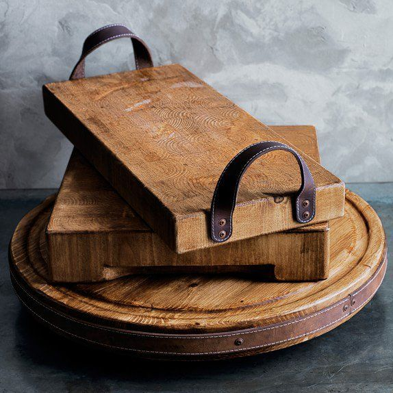 Use scraps of leather and pieces of scrap wood to create a DIY rustic wooden tra...