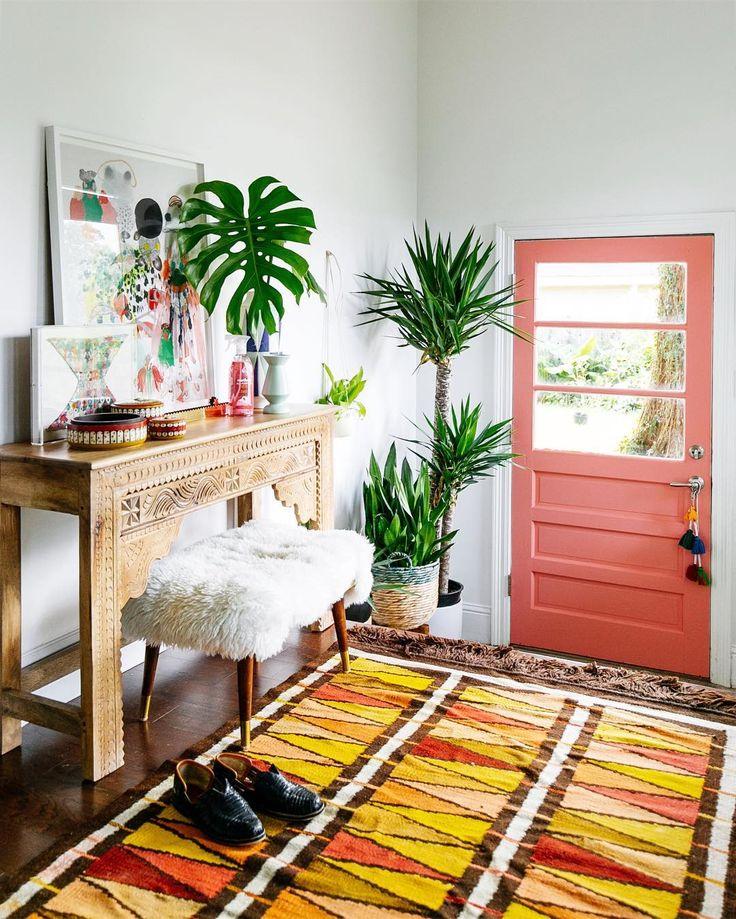 Entryway with colorful coral door