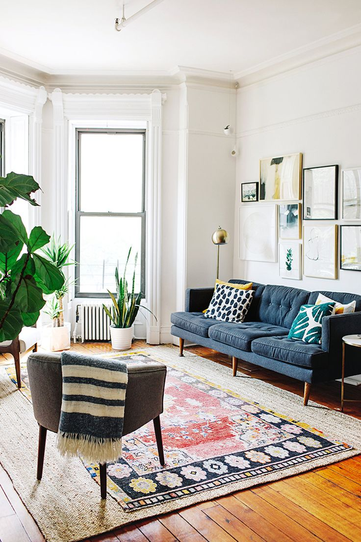 my scandinavian home: mid-century blue sofa and kilim in the laid-back sitting r...