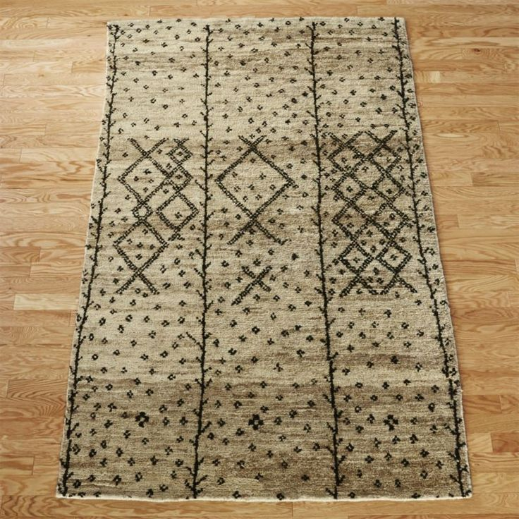 master footwork. Rich in texture and design, plush pile rug is a bit of a chamel...