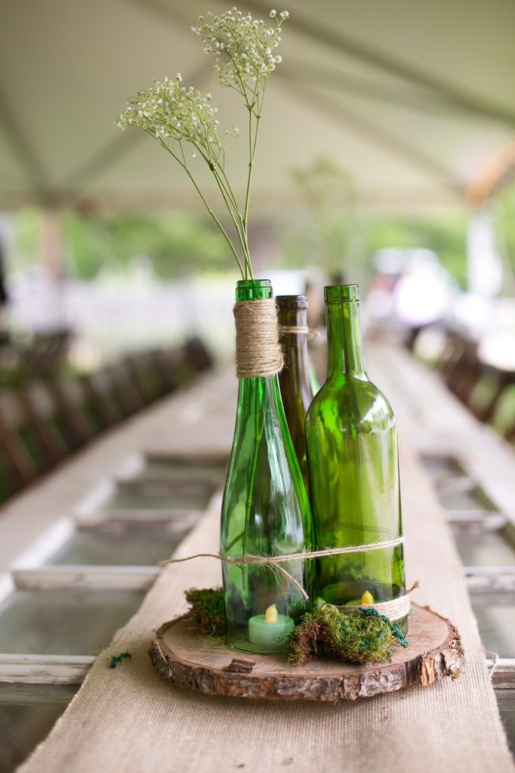 would be cool to use Arthur Ray's old bottles in the wedding like this.