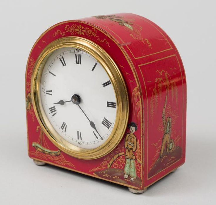 Early 20th century English red chinoiserie desk clock. Front face decorated with...
